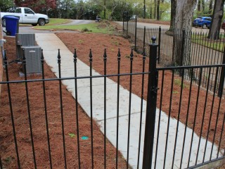 Concrete side walk, iron fence and stairs installations in Birmingham, Al