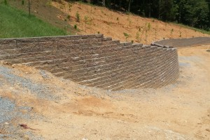 Retaining Wall Installed To Stabilize Hillside Above Driveway